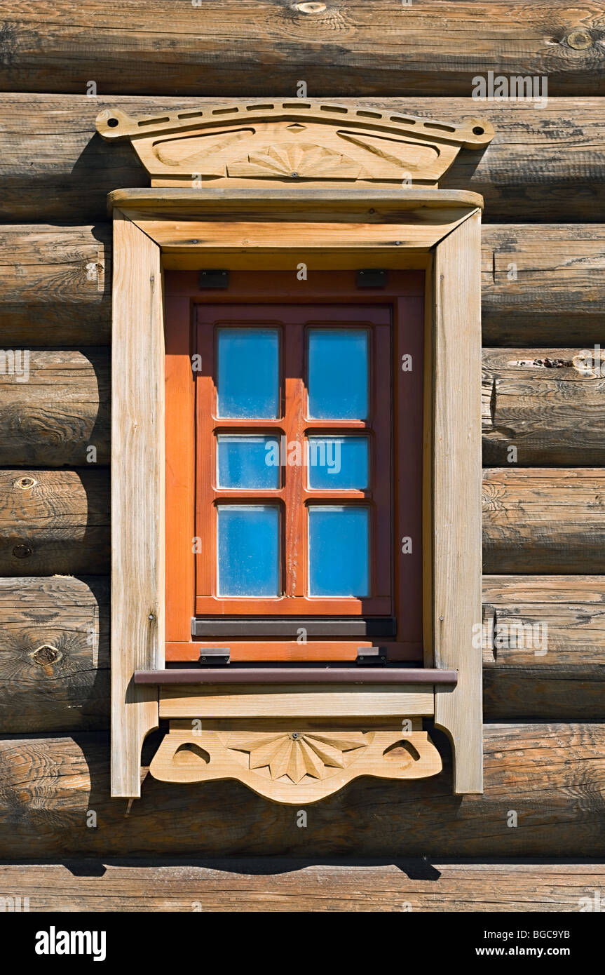 Ancient Russian wooden window in timber house (izba). Close up. Nobody - Stock Image