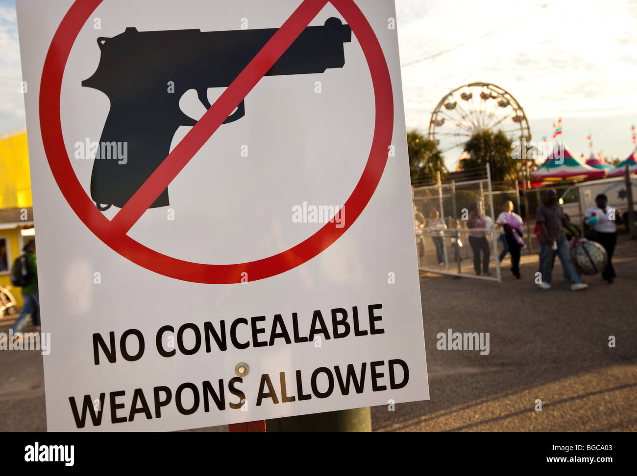 A sign forbidding concealed weapons at the South Carolina Coastal Fair in Charleston, SC. - Stock Image