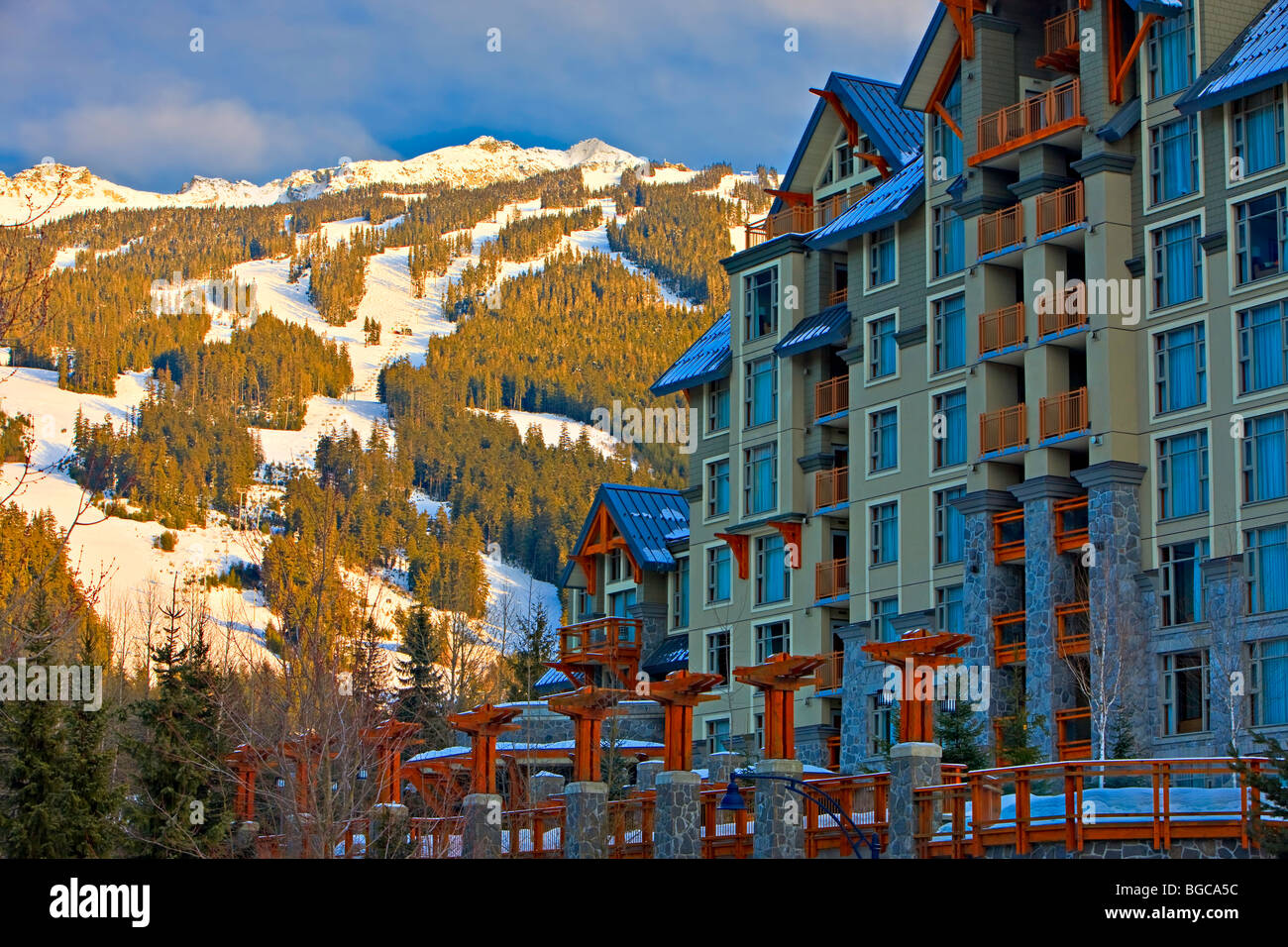 Blackcomb Mountain (2440 metres/8000 feet) and the Pan Pacific Hotel seen from along the Village Stroll, Whistler Stock Photo