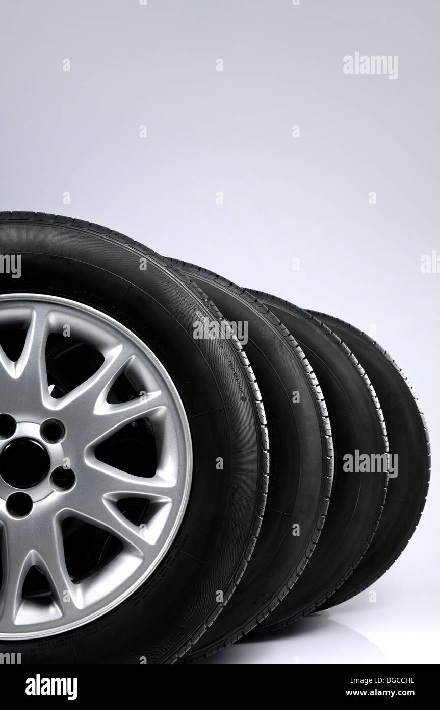 Set of all-season tires isolated on gray background - Stock Image