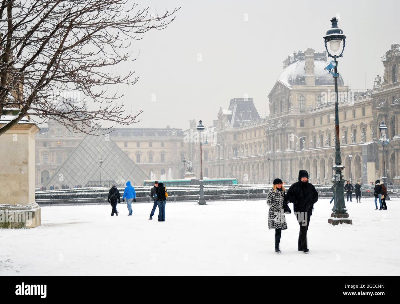 Paris, France, Winter Snow Storm, Tourists  visiting Louvre museum - Stock Image