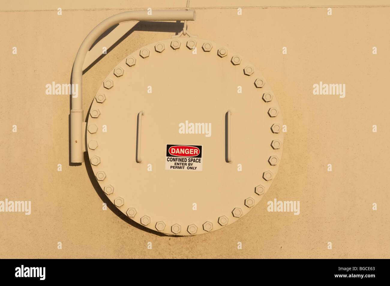 Tank confined space entry with warning sign - Stock Image