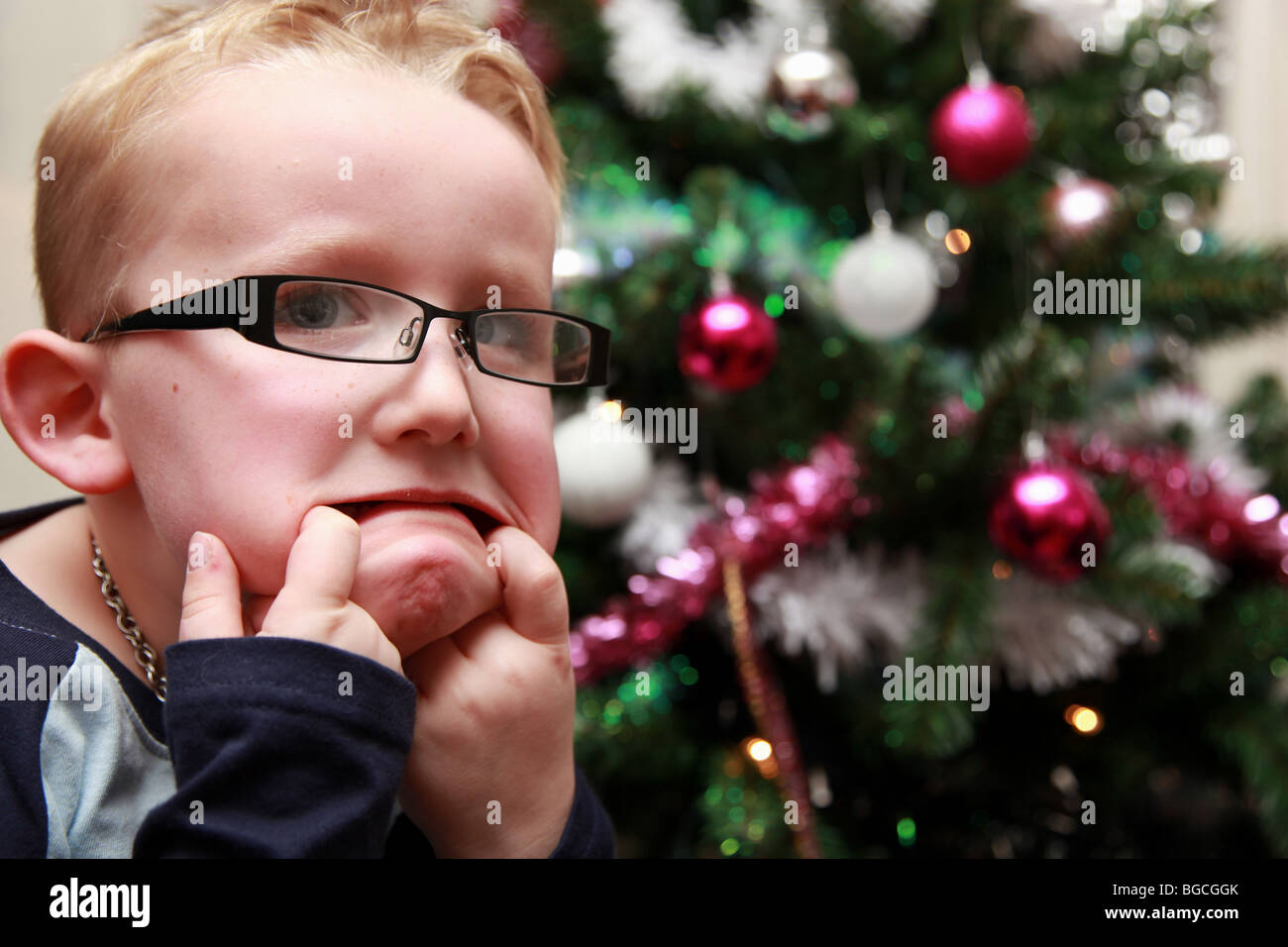 ea1504ae31a3 4 year old boy wearing glasses and pulling faces Stock Photo ...