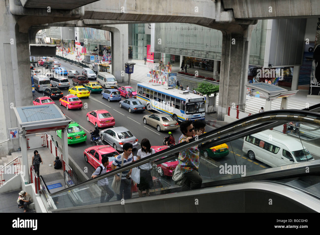 Thailand; Bangkok; Street Scene with Escalator up to Siam BTS Skytrain station - Stock Image