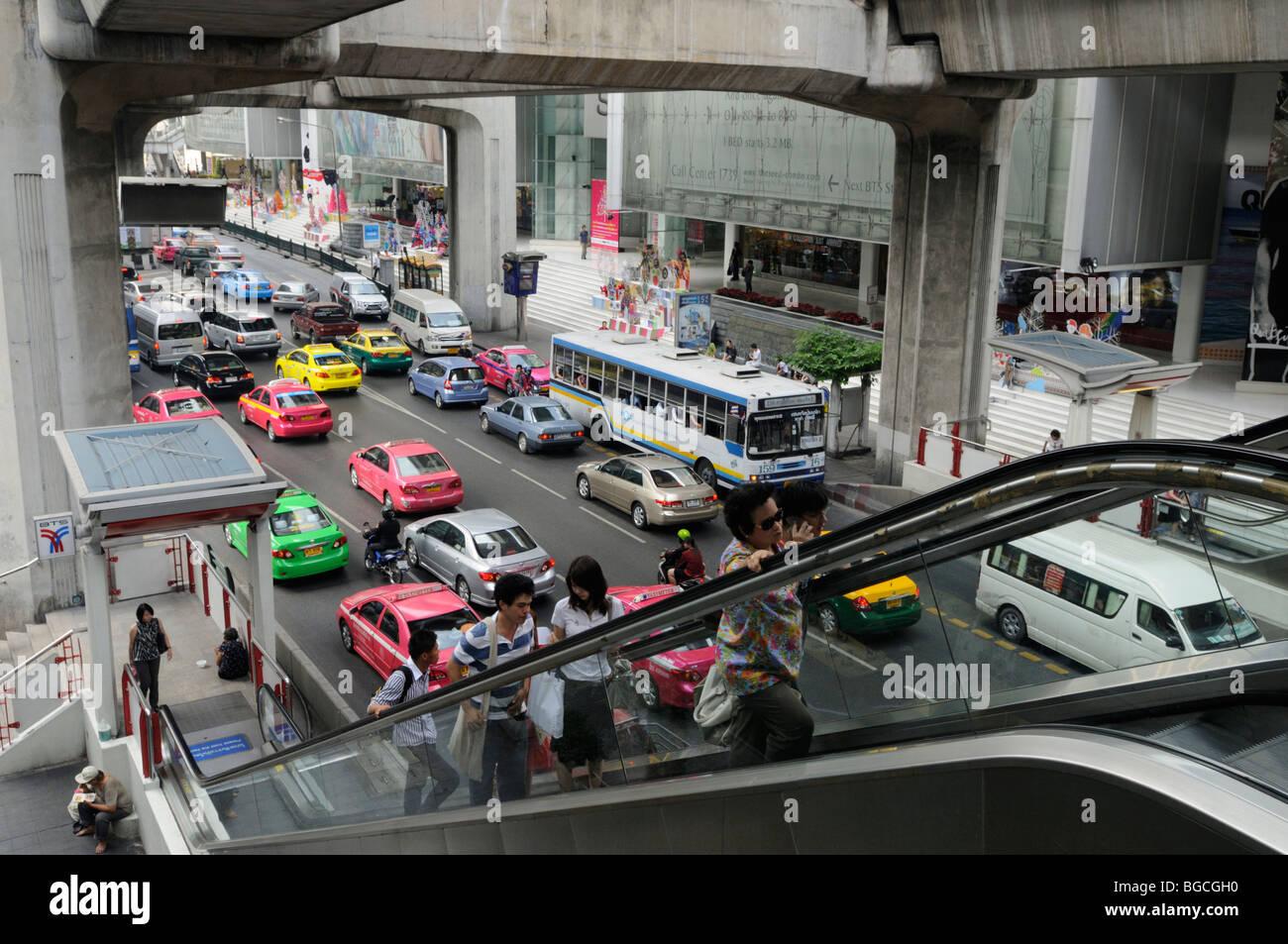 Thailand; Bangkok; Street Scene with Escalator up to Siam BTS Skytrain station Stock Photo