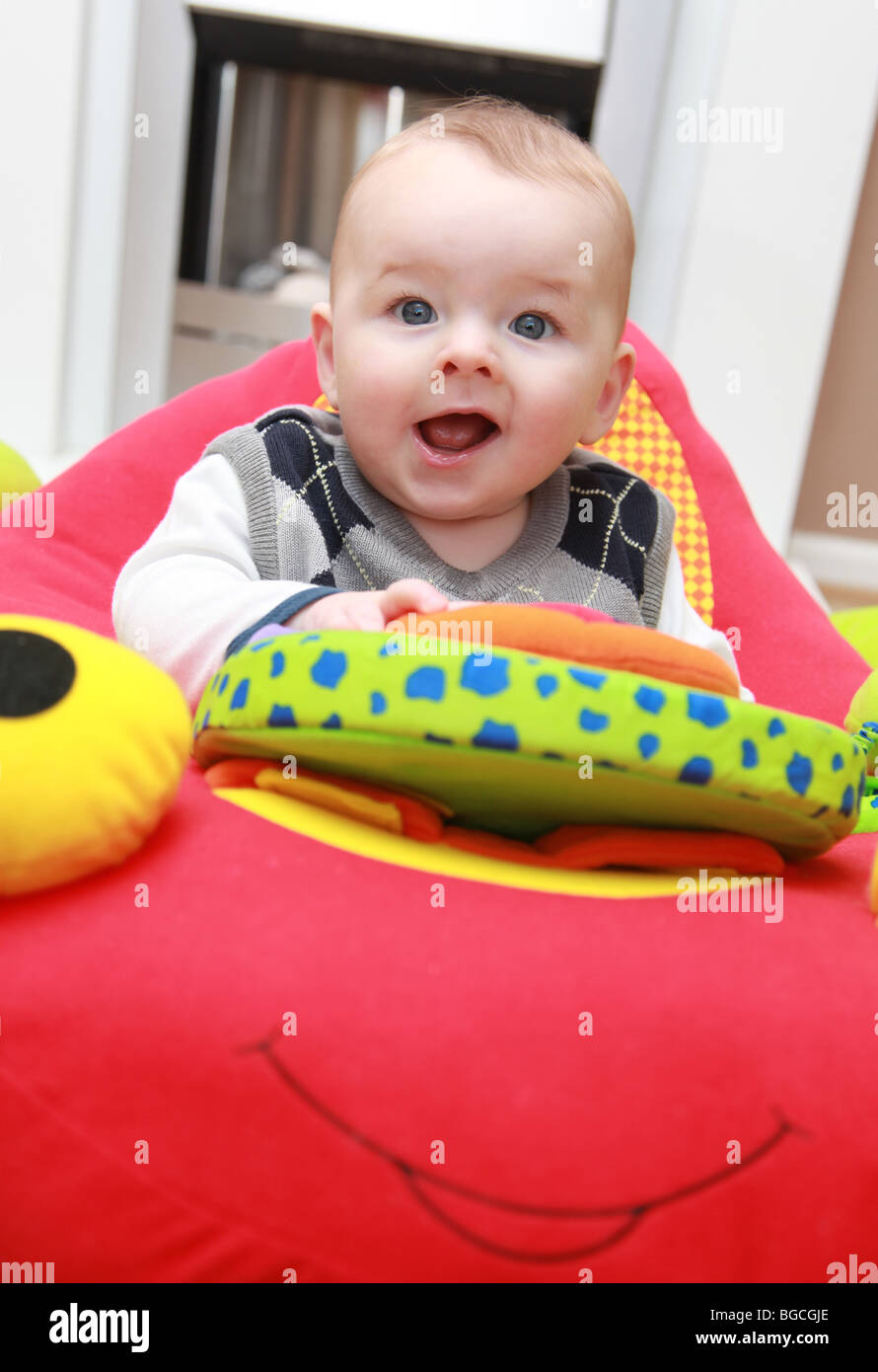 3 4 Month Old Baby Boy Playing With Toys In Cradle Chair Stock