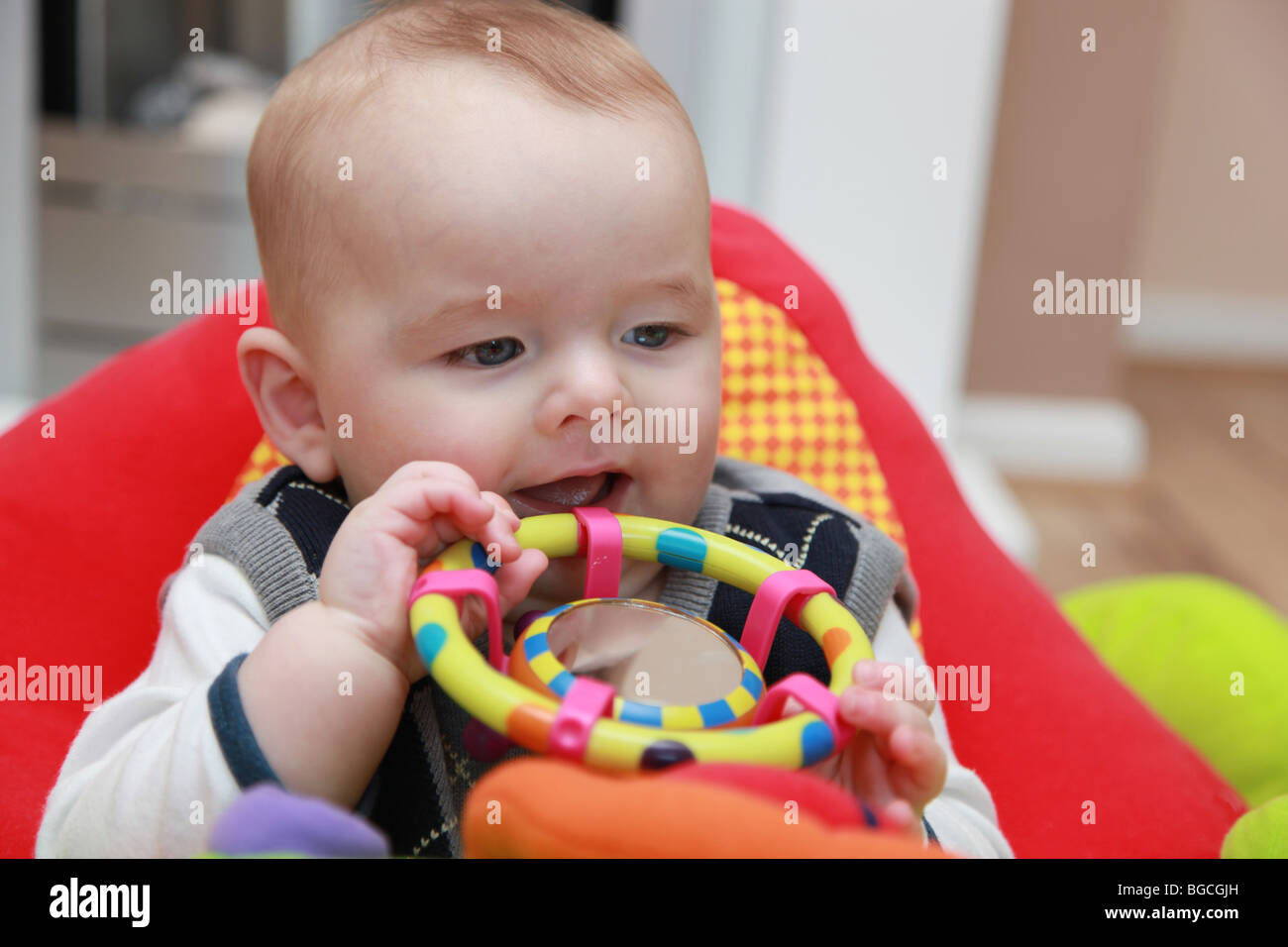 3 4 Month Old Baby Boy Playing With Toys In Cradle Chair
