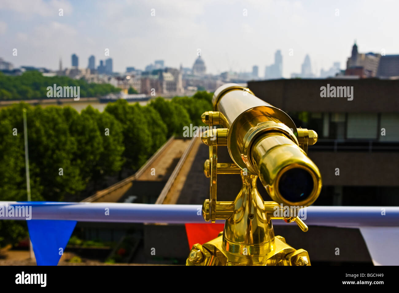 Looking down the eyepiece of a telescope with view over London city and the Thames on Southbank - Stock Image
