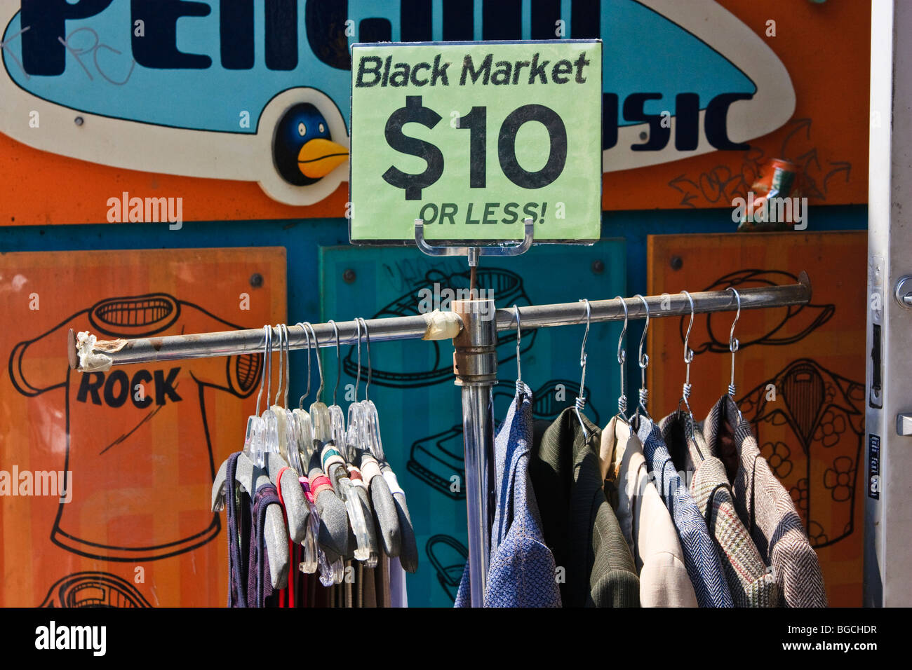 Clothes on a rack with $10 or less price tag. 'Black Market' shop in Toronto, Canada. - Stock Image