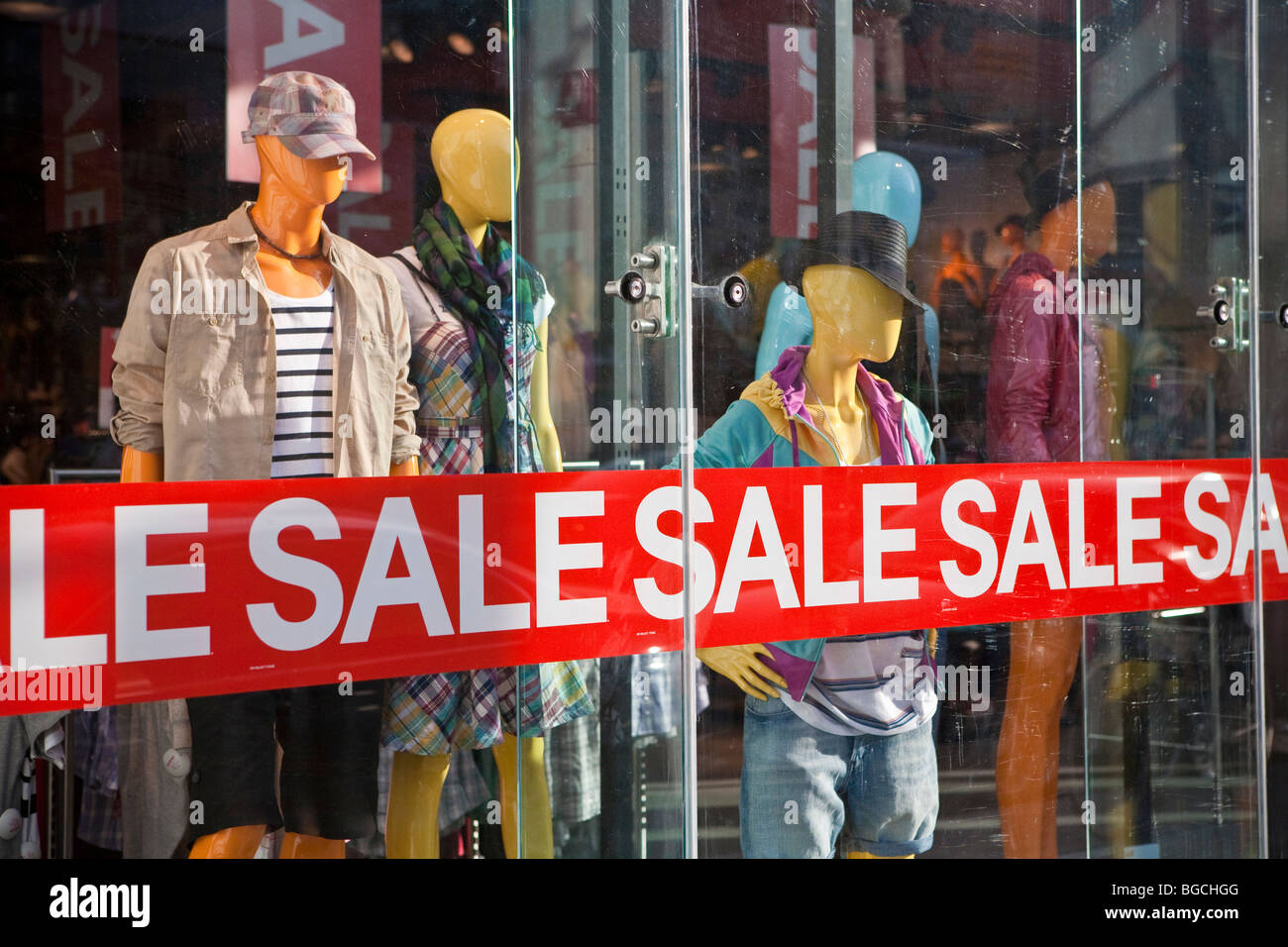 Big 'SALE' sign across a clothing store window, Toronto, Canada - Stock Image