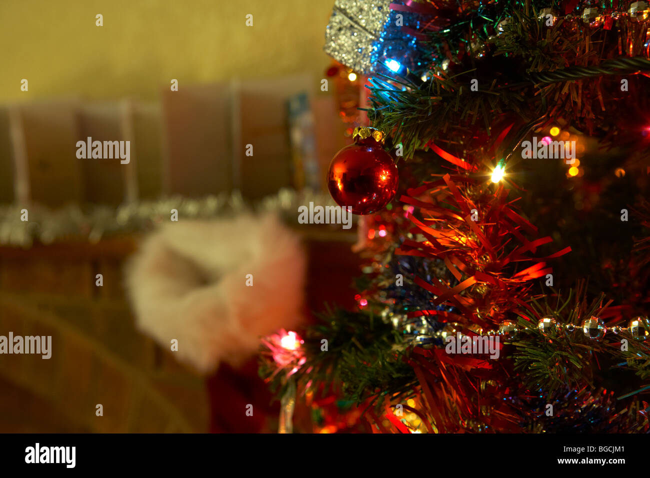 decorated christmas tree on christmas eve night in a living room in the uk Stock Photo