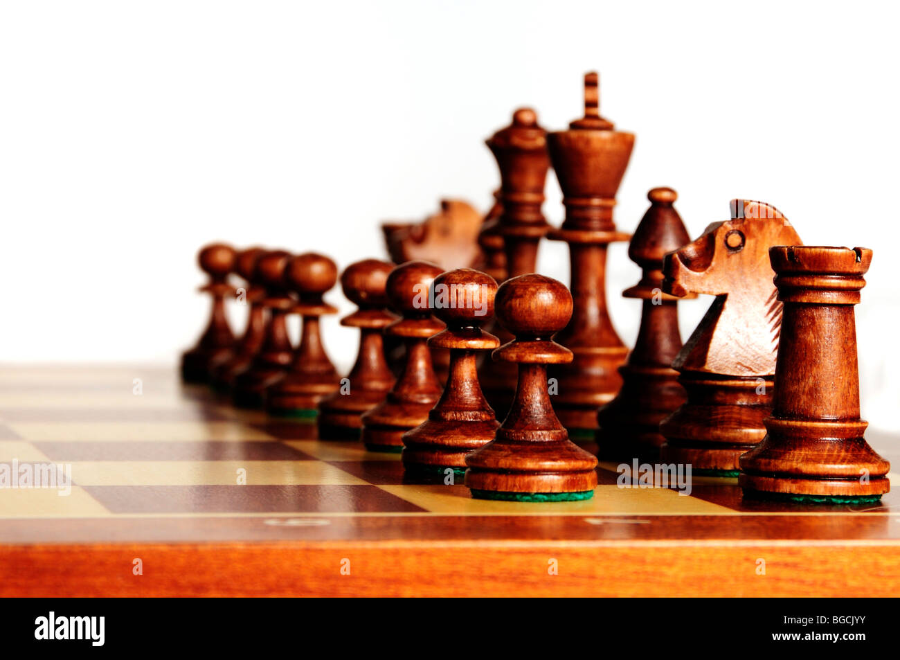 black chess pieces on a chessboard in starting position - Stock Image