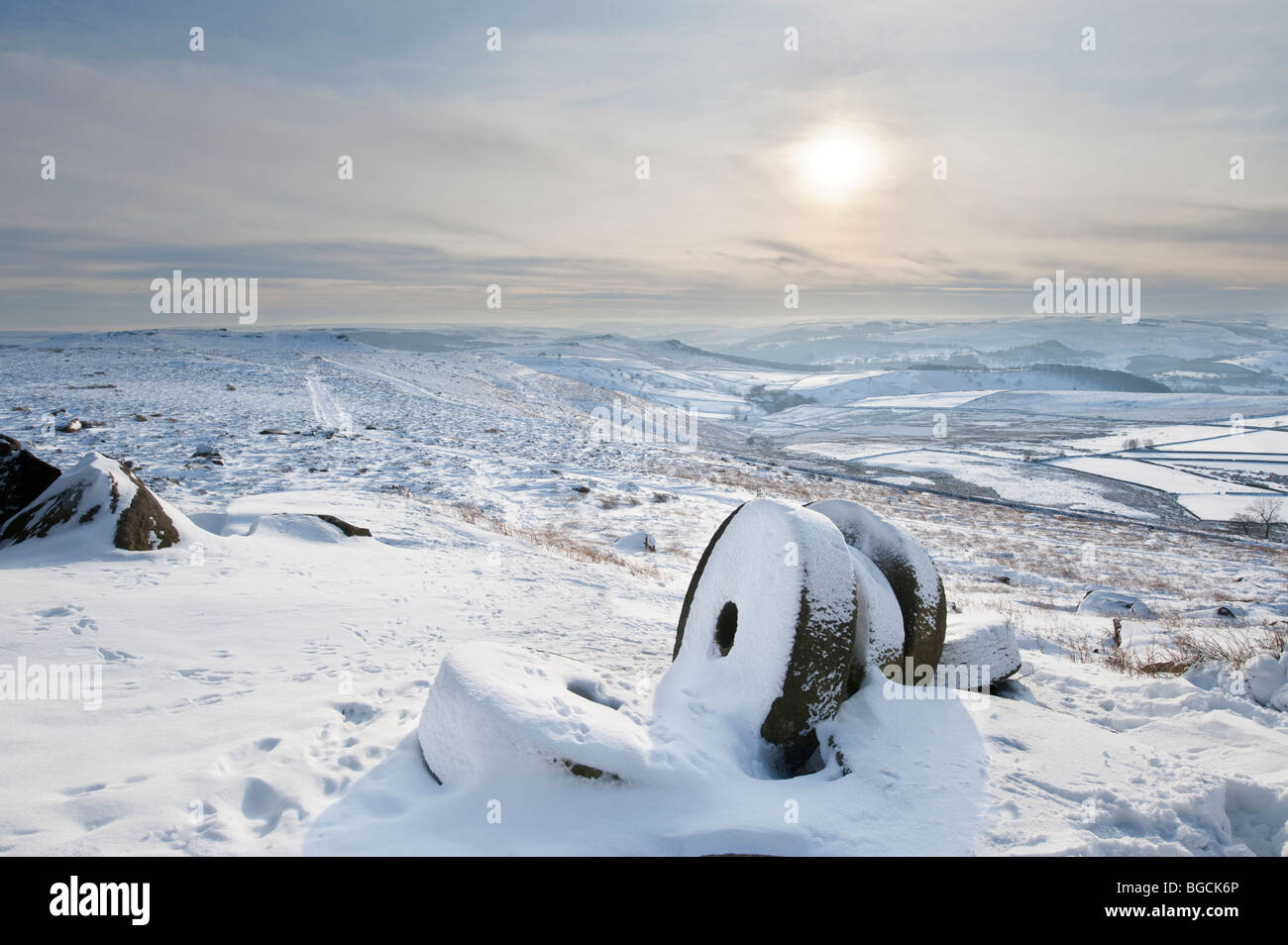 """Abandoned Millstones in Winter Snow under """" Stanage Edge"""" in the """"Peak District"""", Derbyshire, United Kingdom, Great Stock Photo"""
