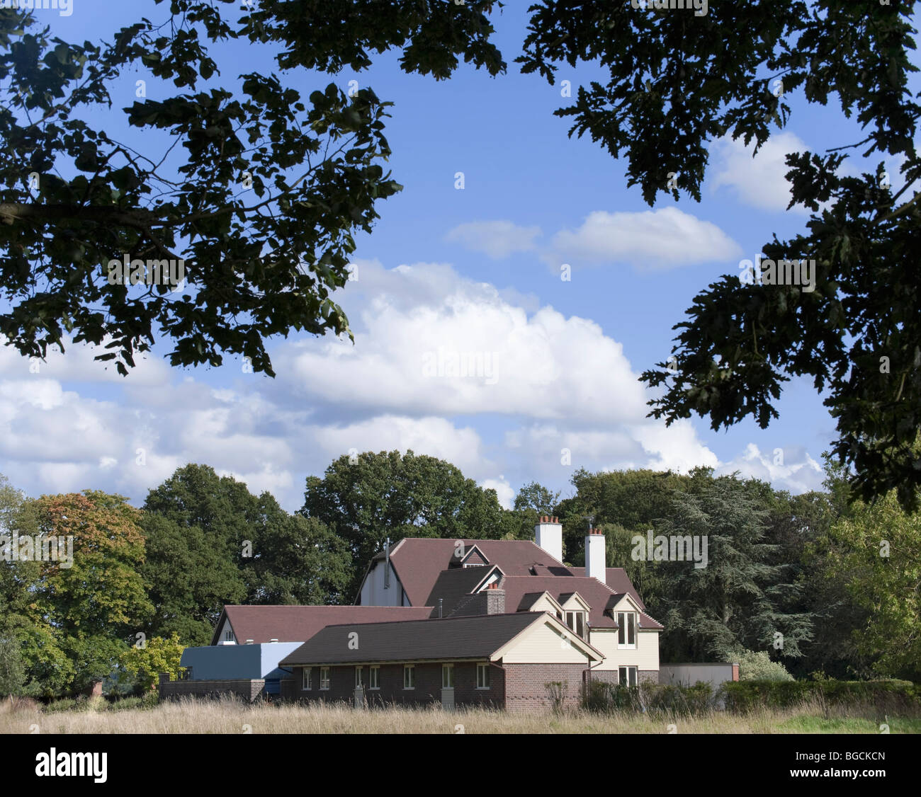 a rural view of a detached house - exterior view and countrside - Stock Image