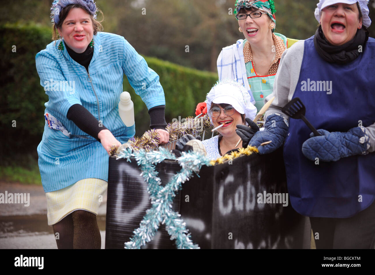 Villagers compete in their annual Boxing Day pram race event. East Hoathly near Lewes, UK. Picture Jim Holden. - Stock Image