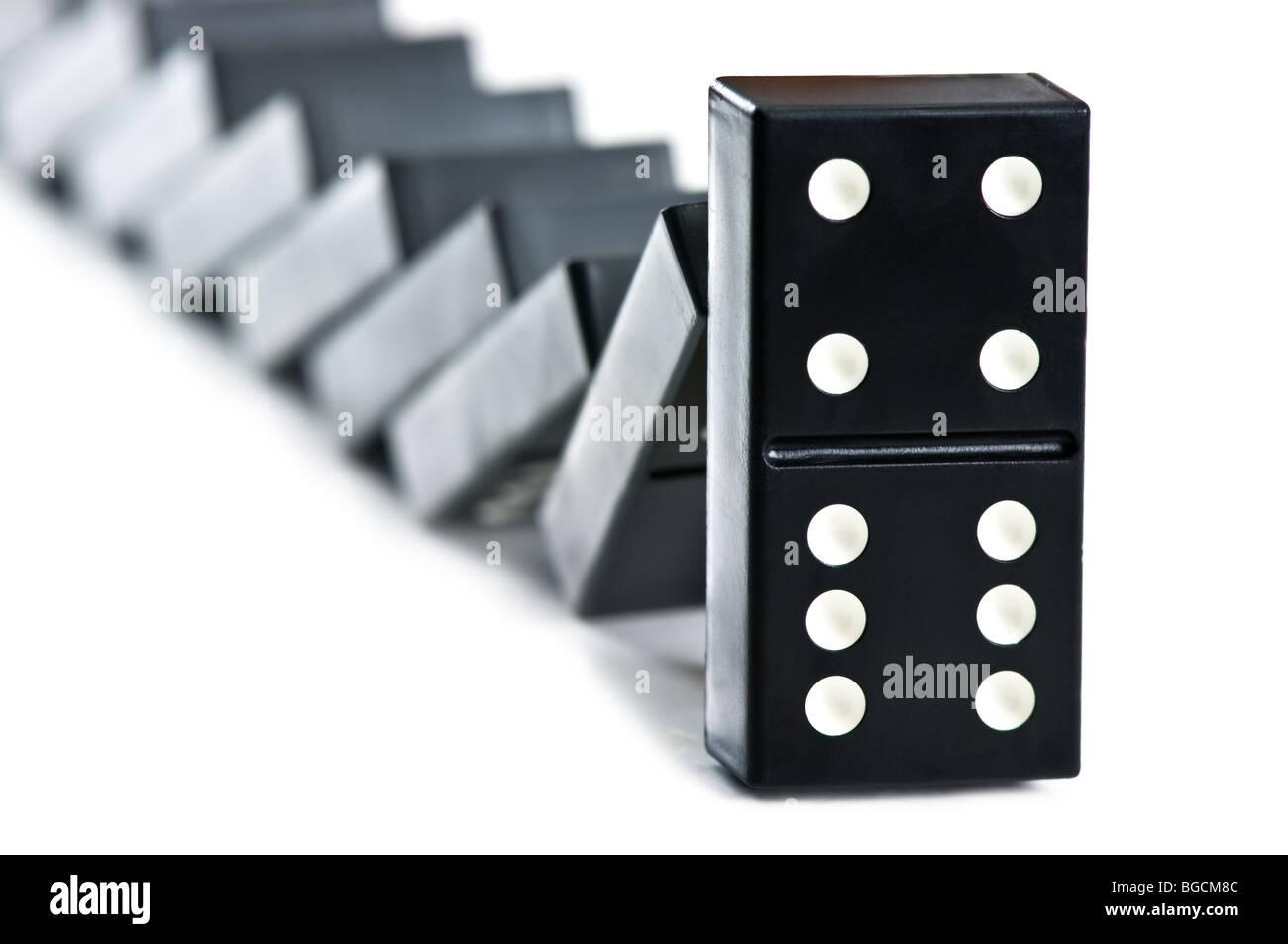 black domino falling - Stock Image