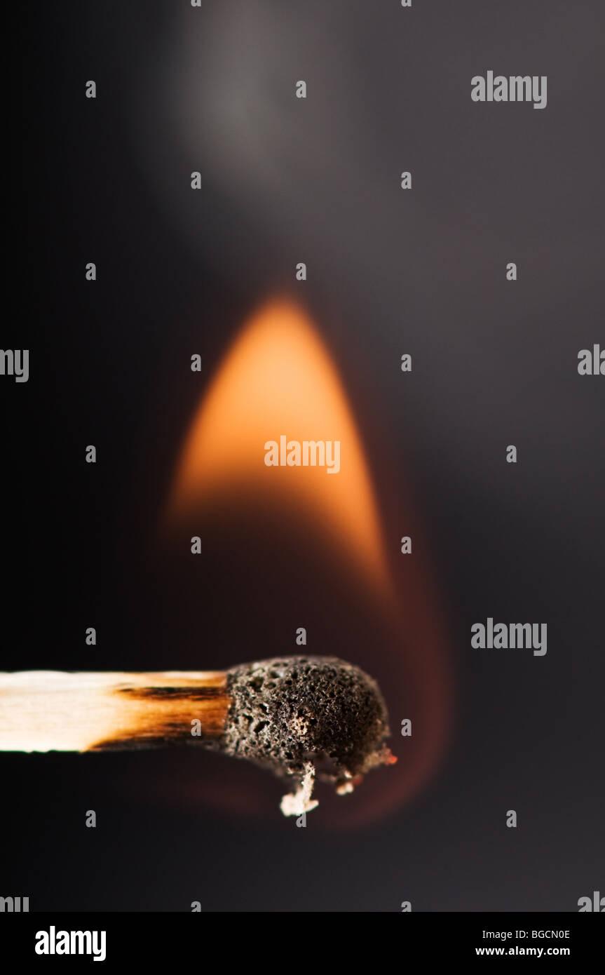 burning matchstick closeup - Stock Image