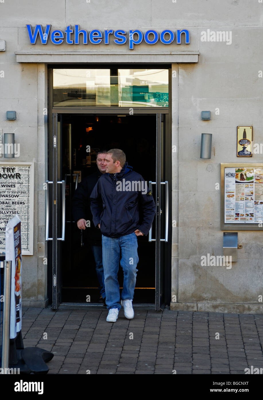 two men coming out of a wetherspoons pub in truro,cornwall,uk - Stock Image