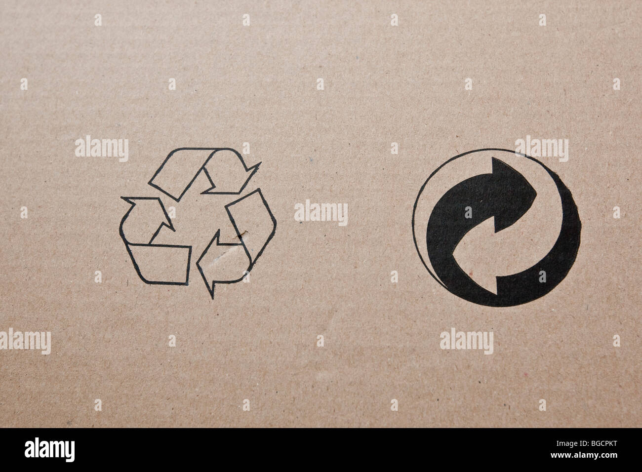 Two international recycling symbols on a piece of cardboard, December 2009. - Stock Image