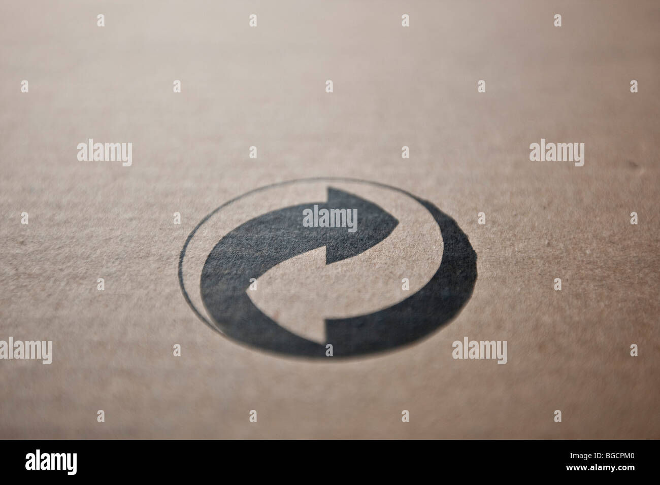 The Green Dot (Der Grüne Punkt) recycling symbol on a piece of cardboard, December 2009. - Stock Image