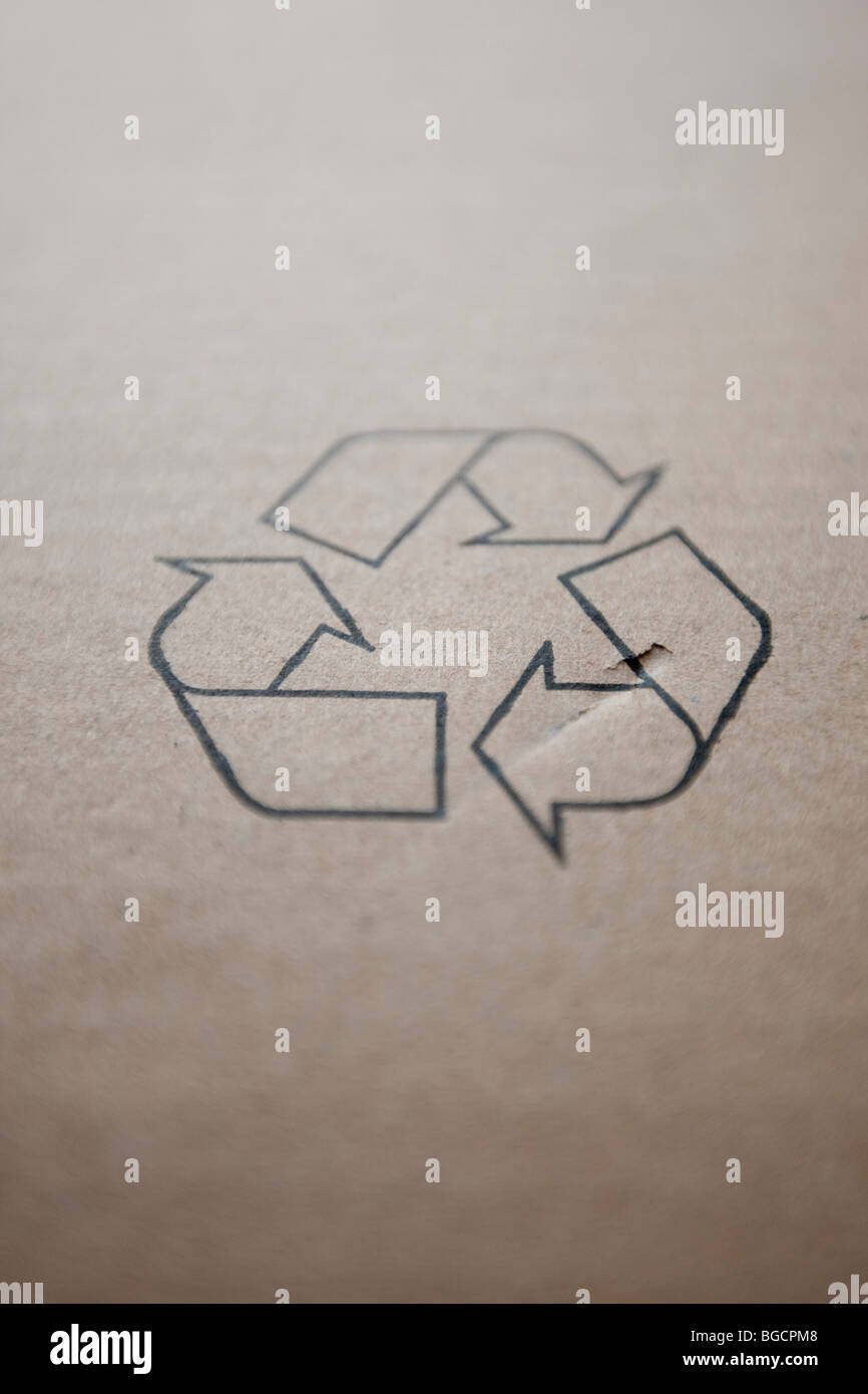 International recycling symbols on a piece of cardboard, December 2009. - Stock Image