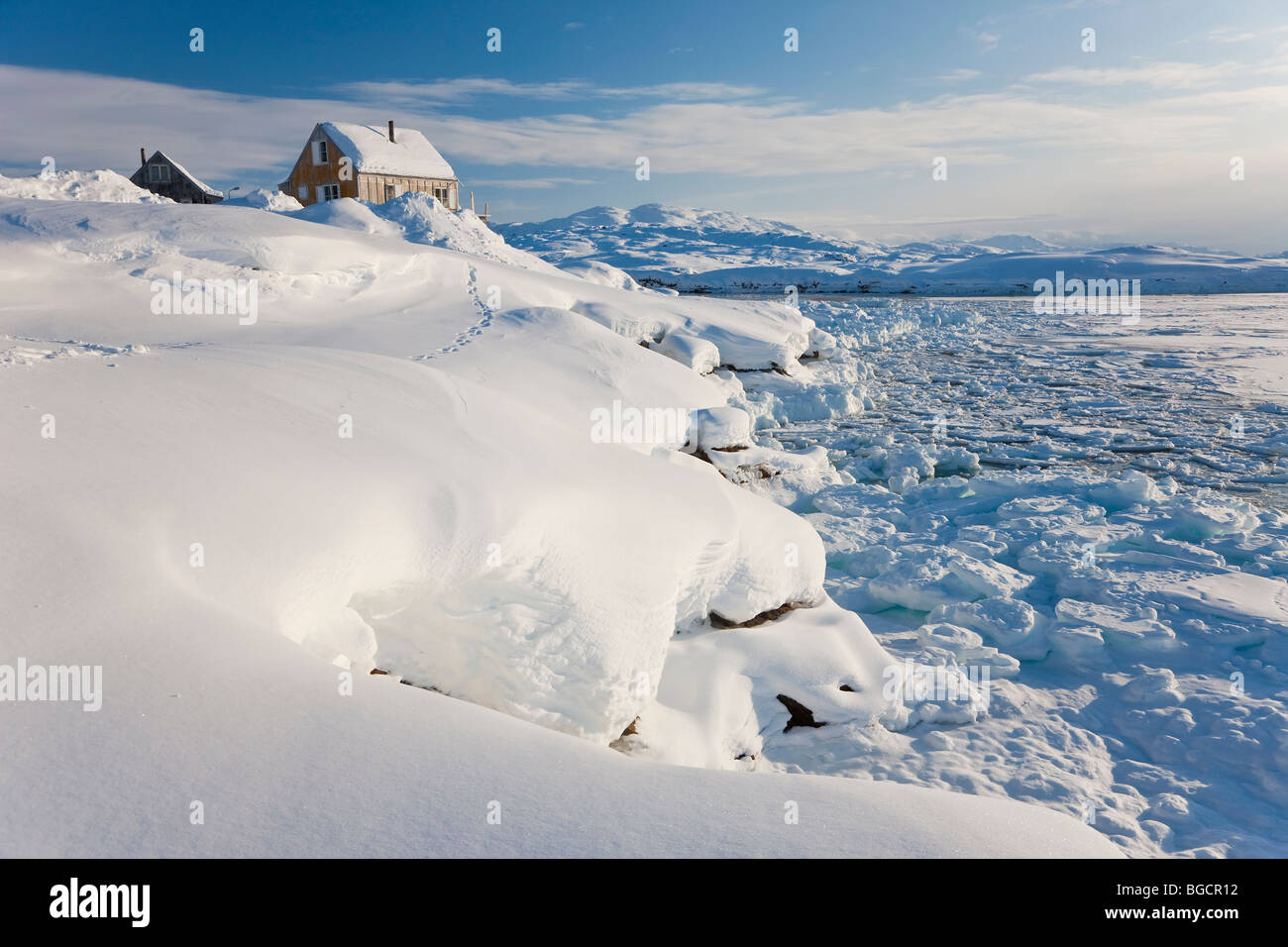 House on edge of fjord, Tiniteqilaq, Greenland - Stock Image
