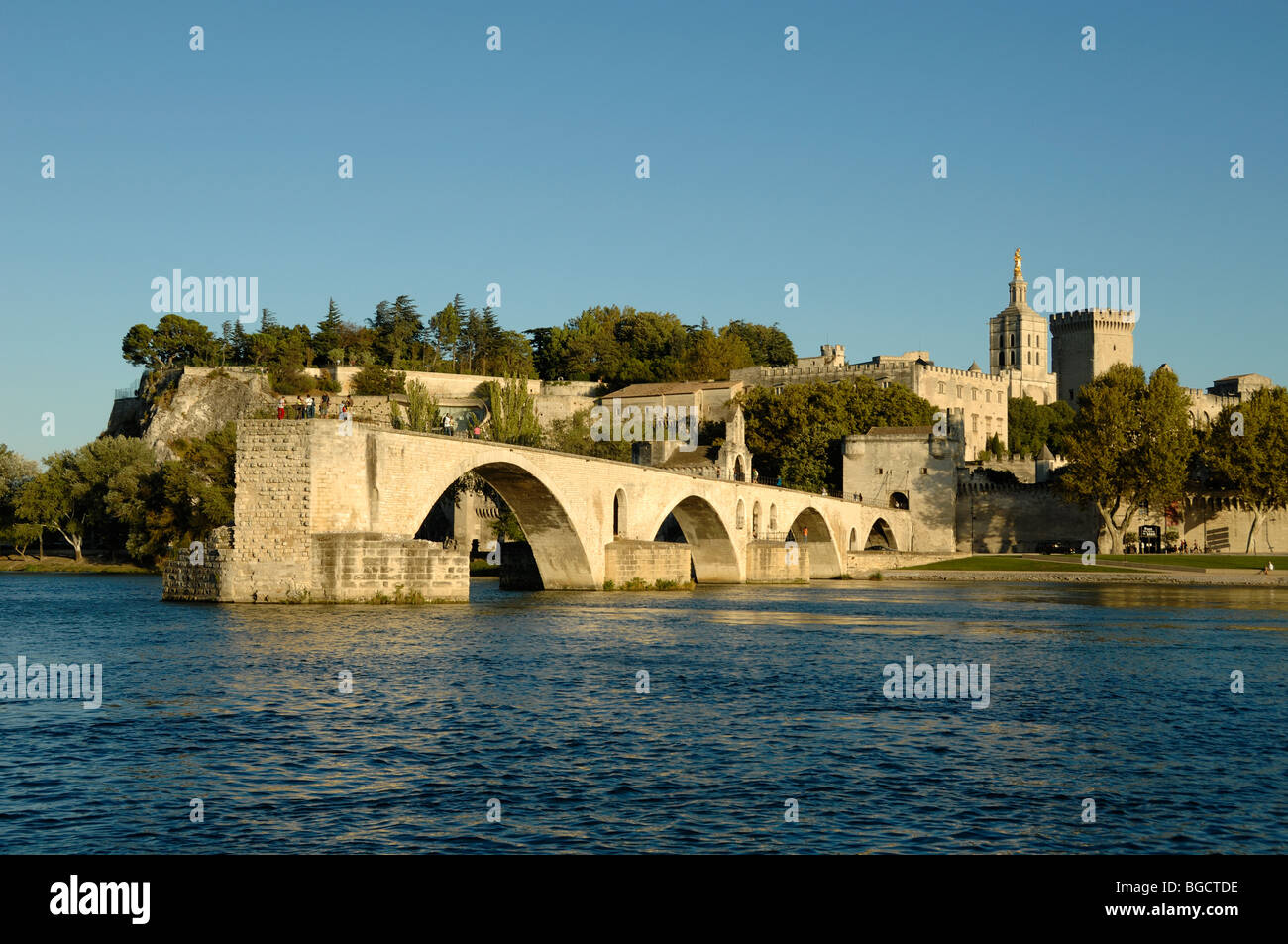 Le Pont d'Avignon or Saint Bénézet Bridge on River Rhone with Palais des Papes or Popes Palace Behind, - Stock Image