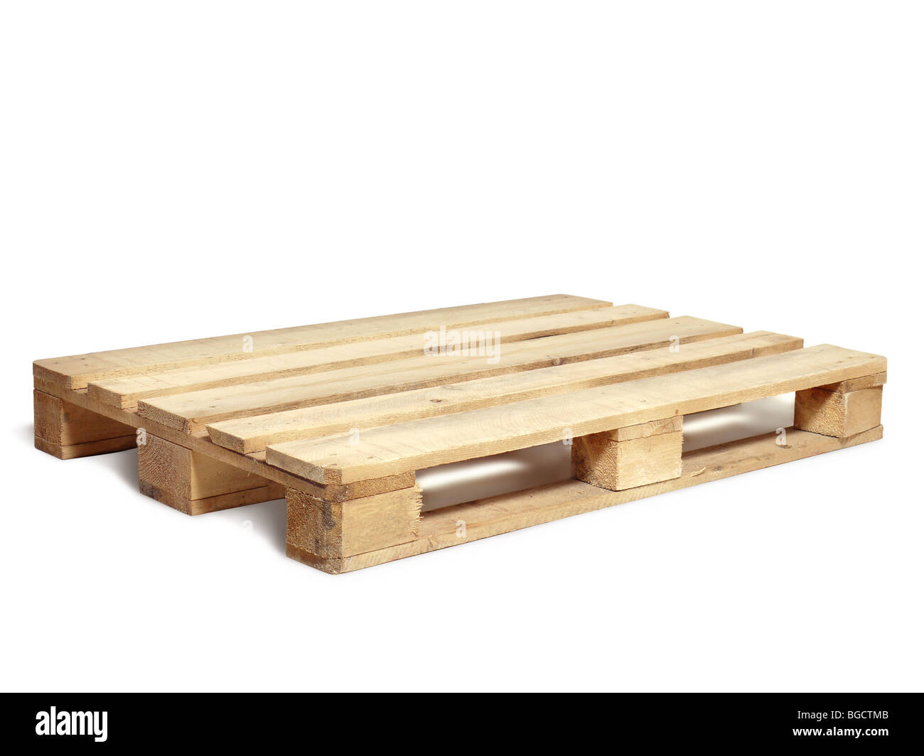 Wooden warehouse pallet shot over white background - Stock Image