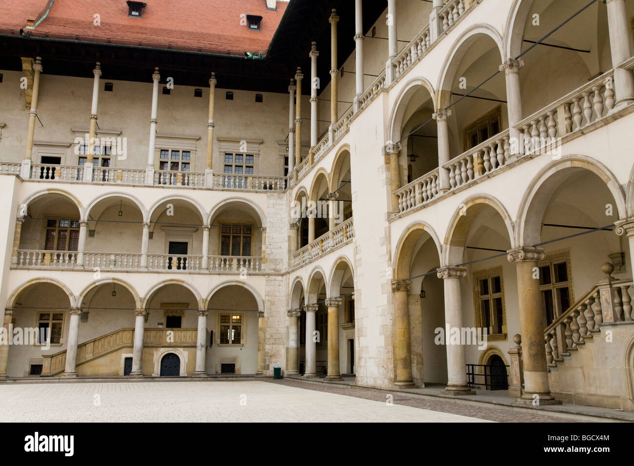 The arched cloisters around the 16th Century Renaissance style courtyard. Wawel Castle. Krakow, Poland. Stock Photo