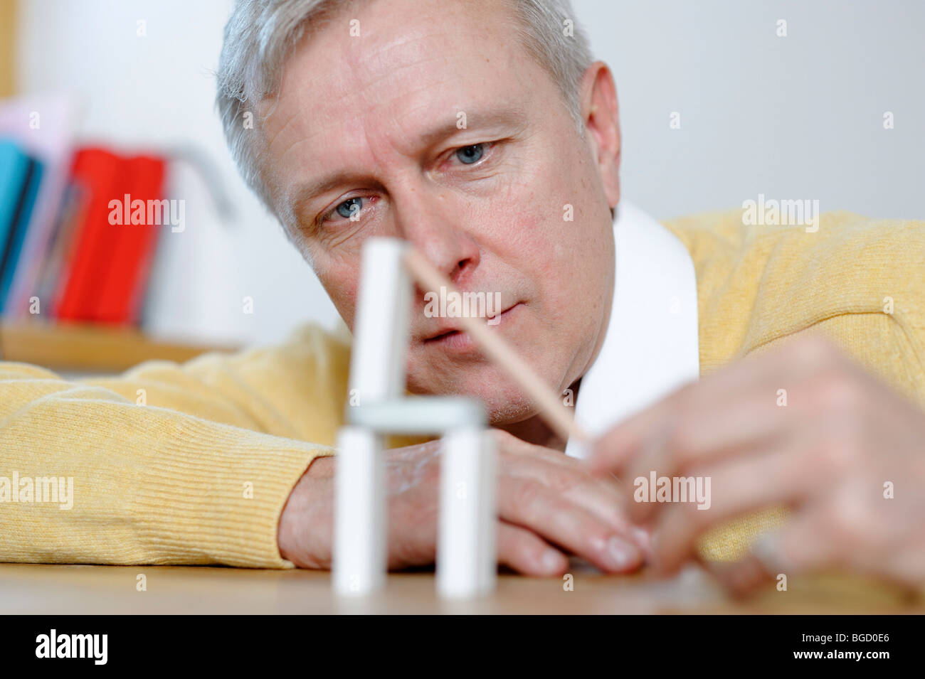 Man, engineer, inventor, architect thinking, playing, inventing, planing, constructing - Stock Image
