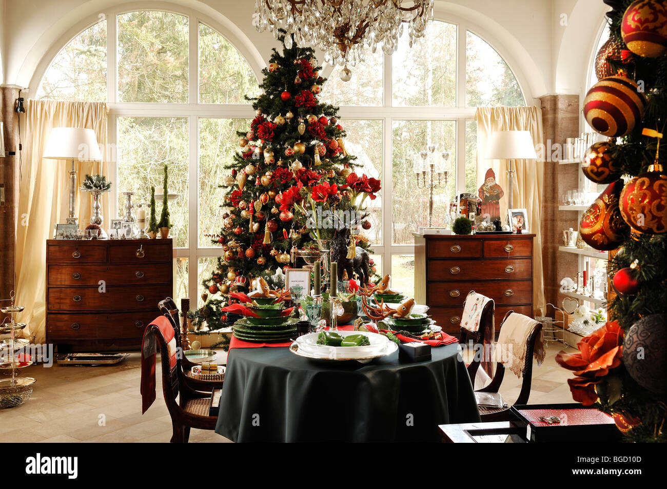 decorated christmas tree in a conservatory with a decorative table setting for sale villa ambiente store im weller nurembe