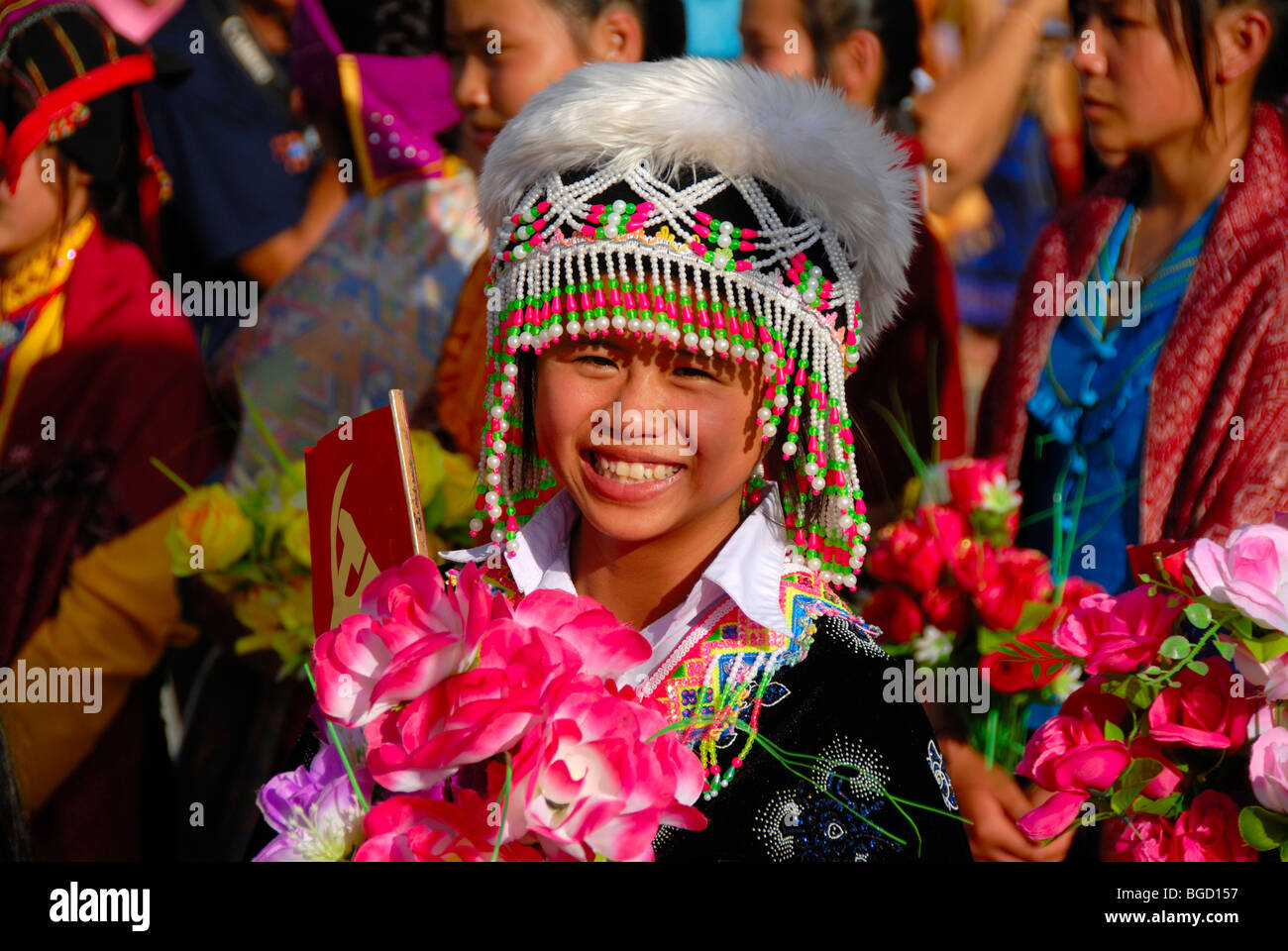 Festival, young Hmong woman, portrait, dressed in traditional clothing, colourful headwear, Xam Neua, Houaphan province, - Stock Image