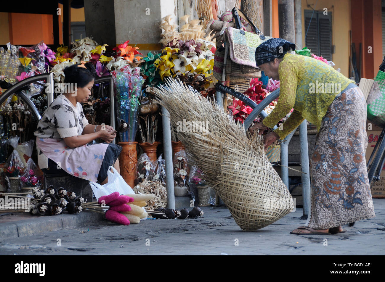 Woman selling baskets as packaging materials to retailers, Jogyakarta, Central Java, Indonesia, Southeast Asia, - Stock Image