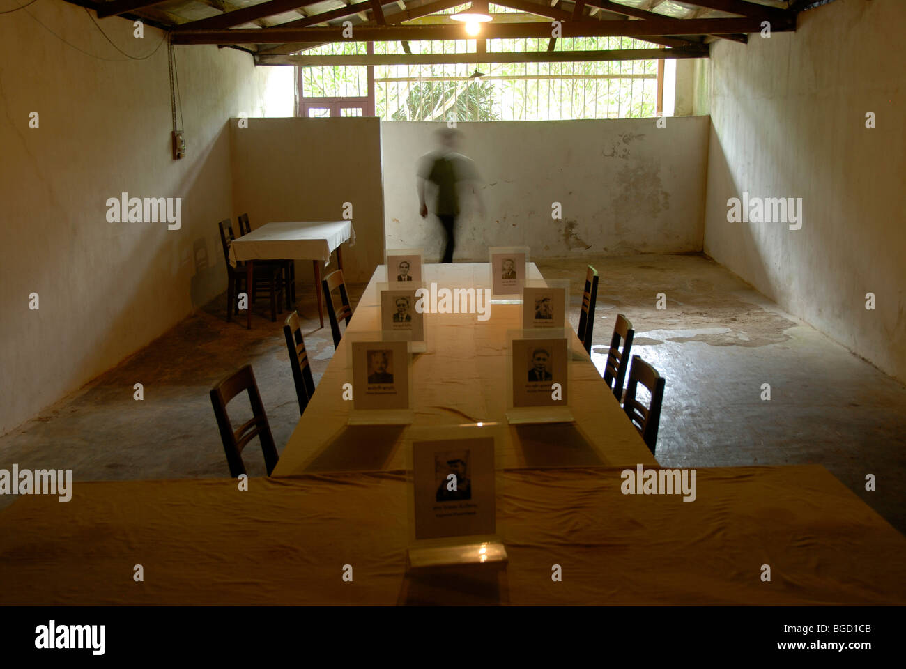 History, furnished cave of the Communist Pathet Lao resistance fighters, table and chairs, old photos of politicians, - Stock Image
