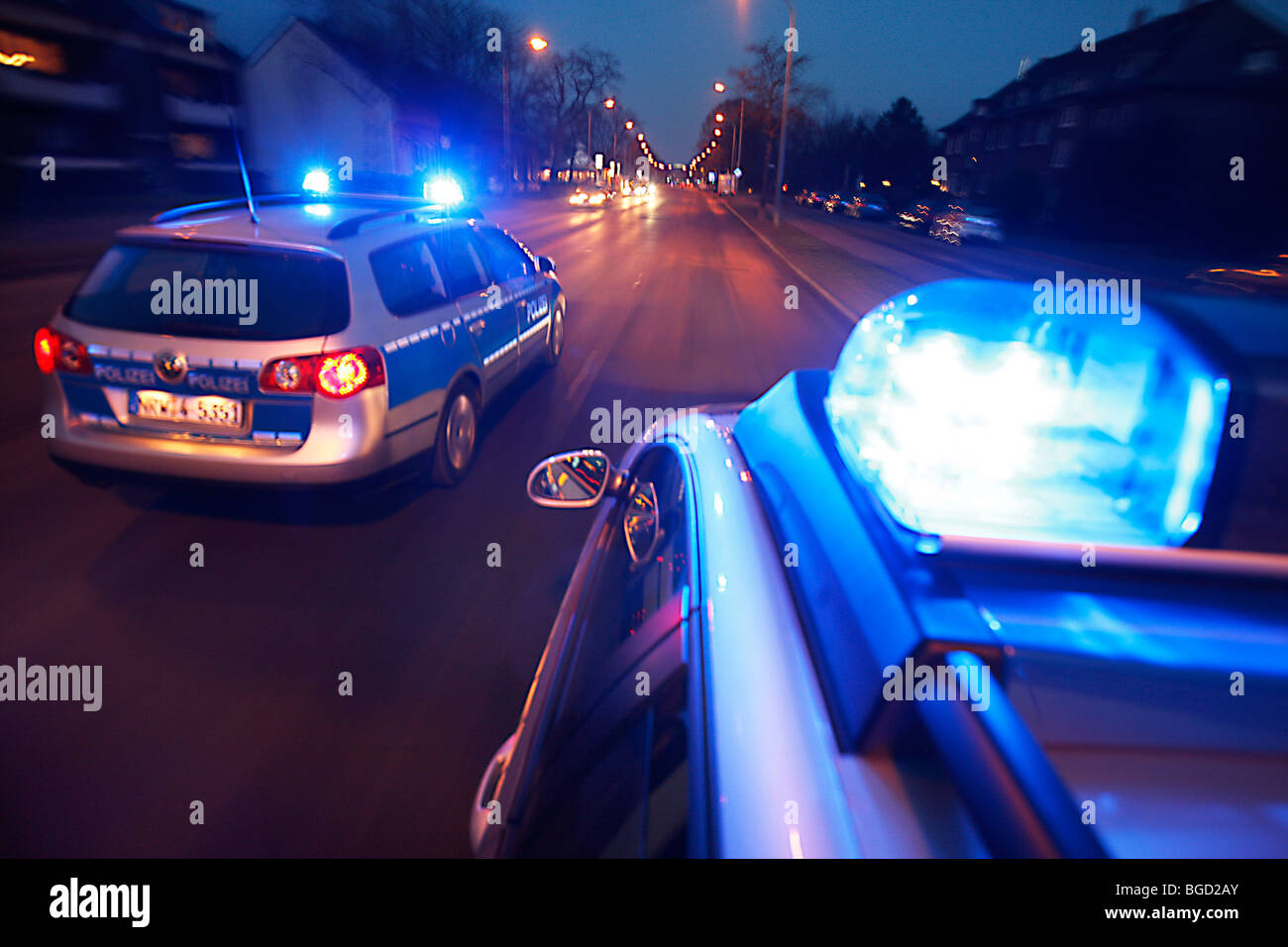 patrol car of the police in operation with blue lights switched on and siren, Germany, Europe. Stock Photo