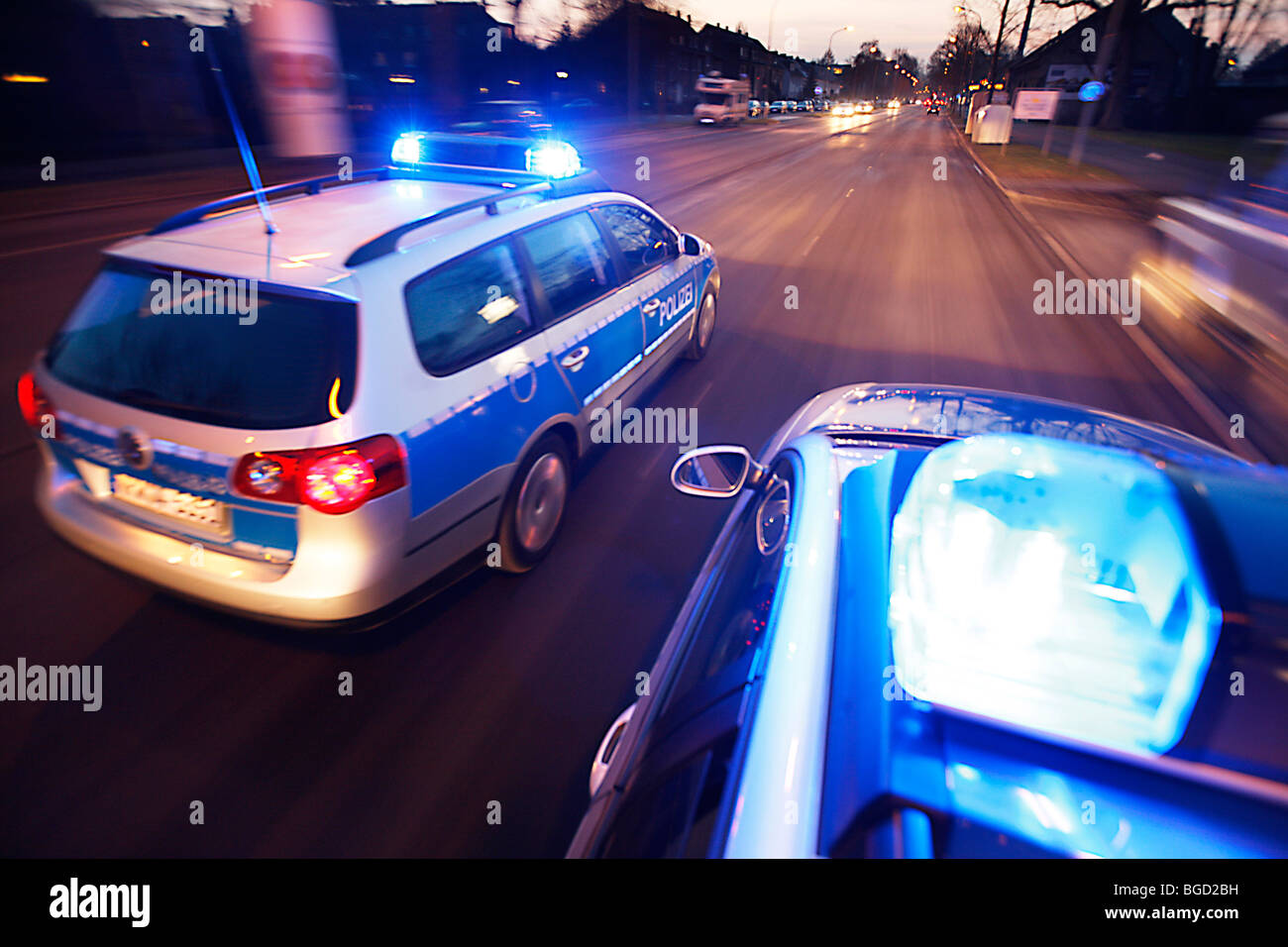 patrol car of the police in operation with blue lights switched on and siren, Germany, Europe. - Stock Image