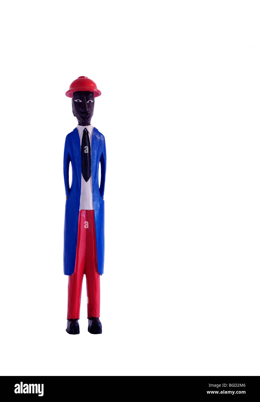 Wood carving of native African in colonial dress. Copy space. White background. Color. - Stock Image