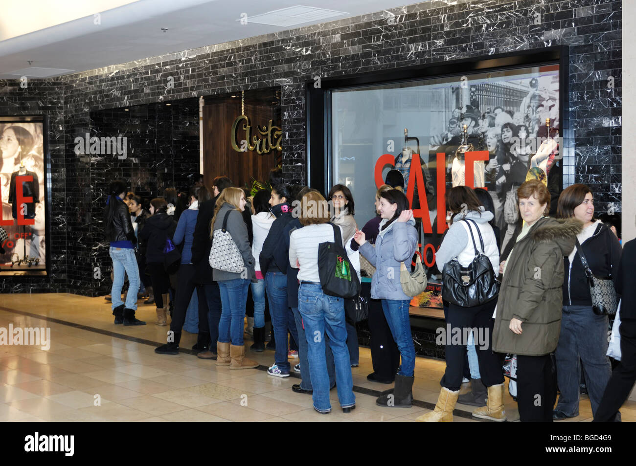 People lined up in front of a store in a shopping mall on a Boxing Day in Toronto, Canada. - Stock Image