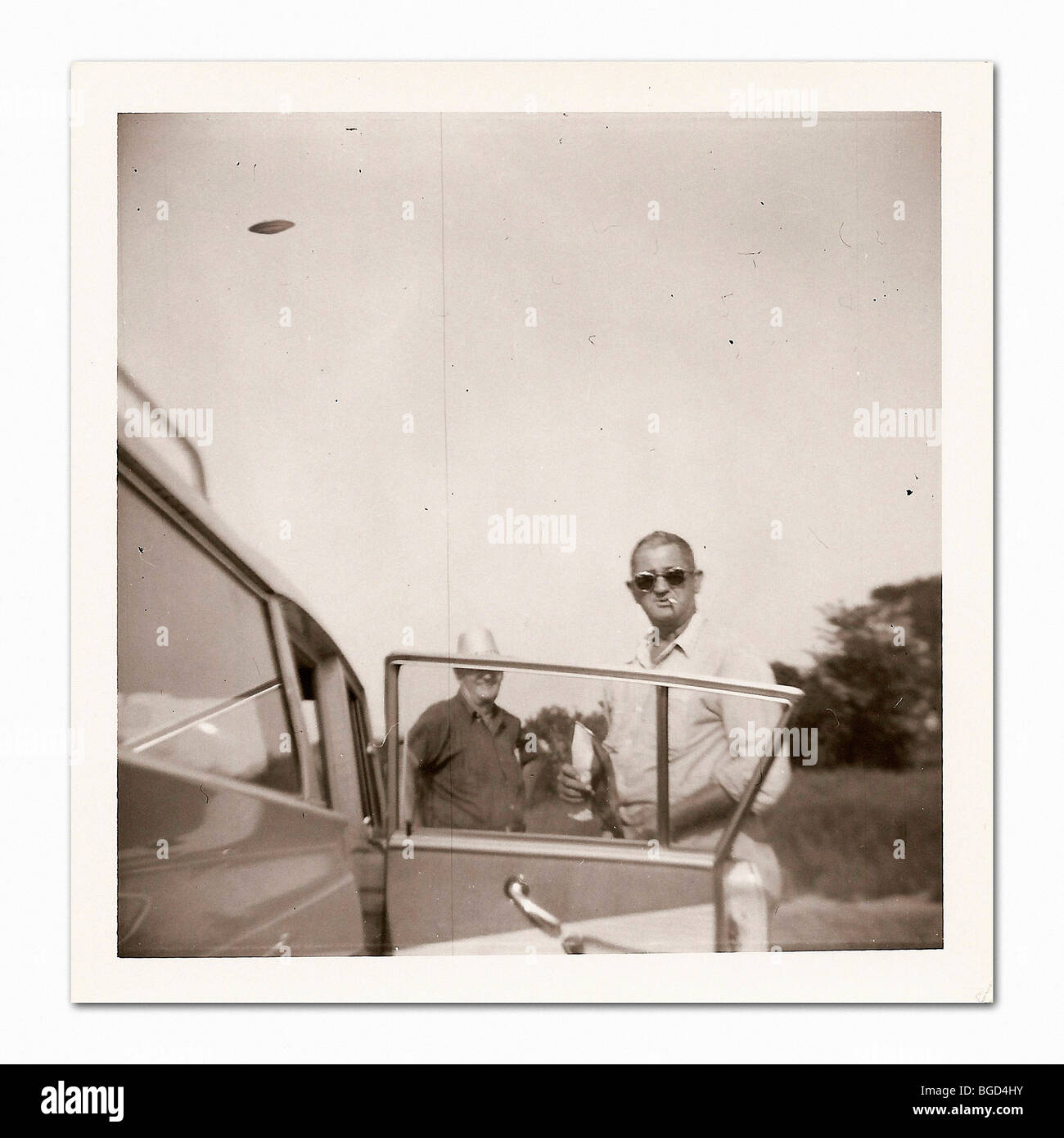 'Vintage' Polaroid photo snapshot with UFO in sky. - Stock Image