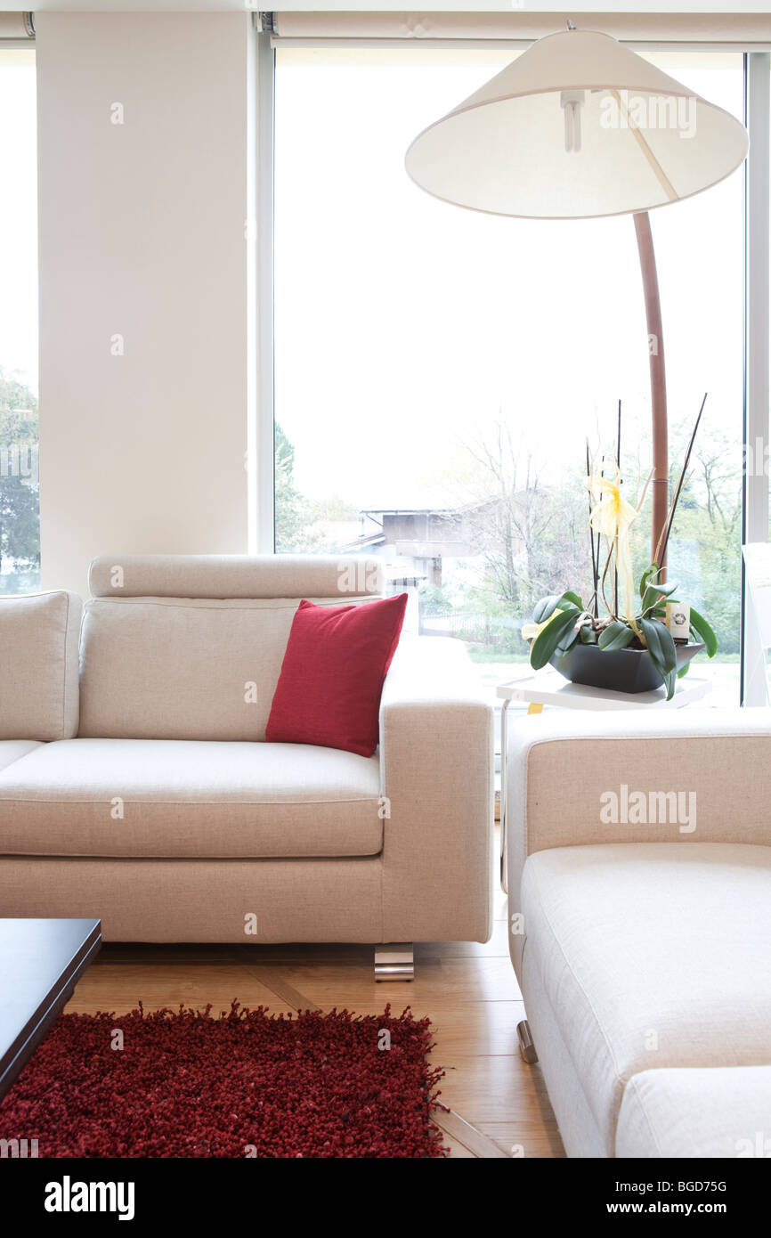 White Sofas With Red Carpet And Modern Lamp Stock Photo - Alamy
