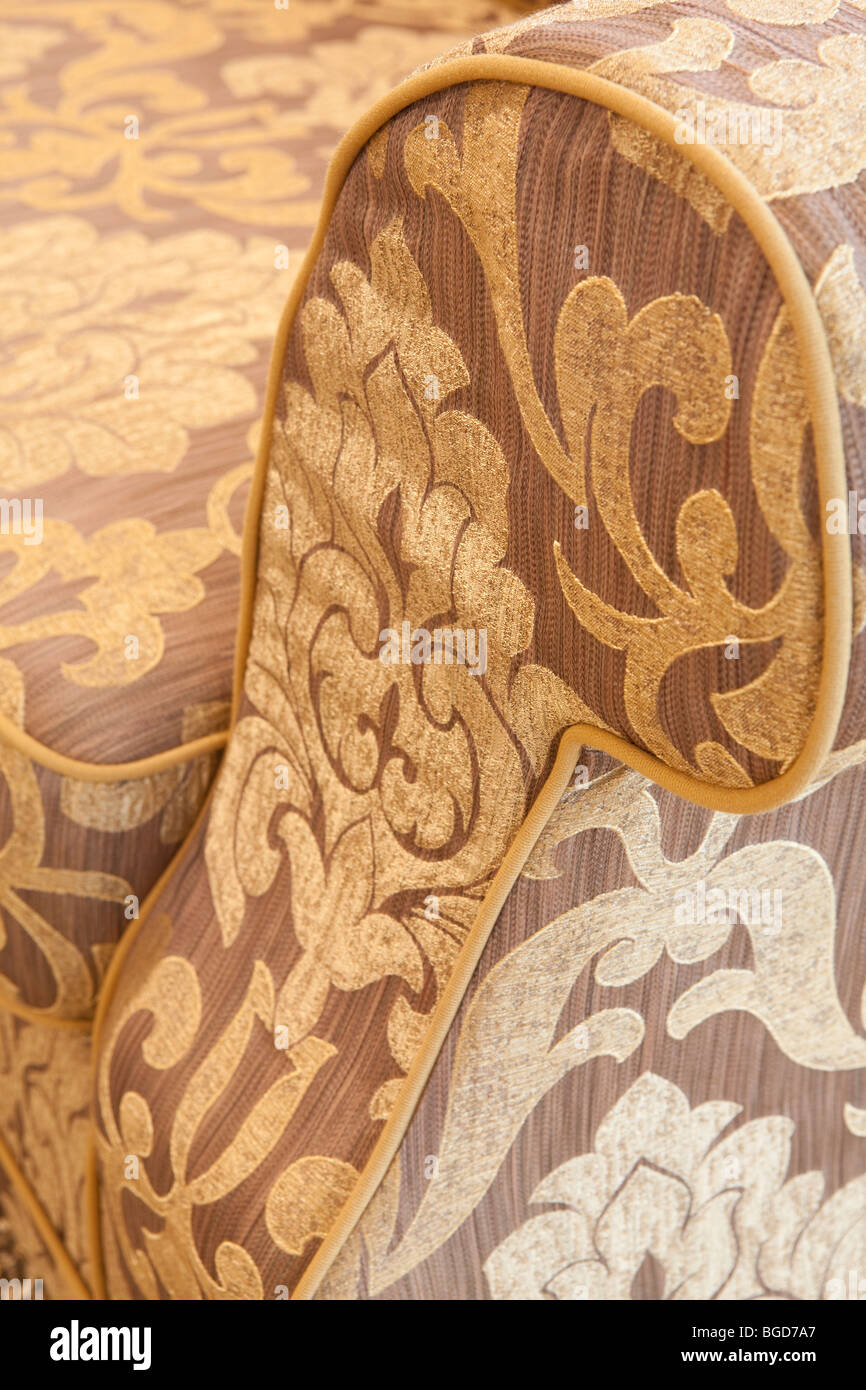Upholstered couch with classic style fabric detail - Stock Image