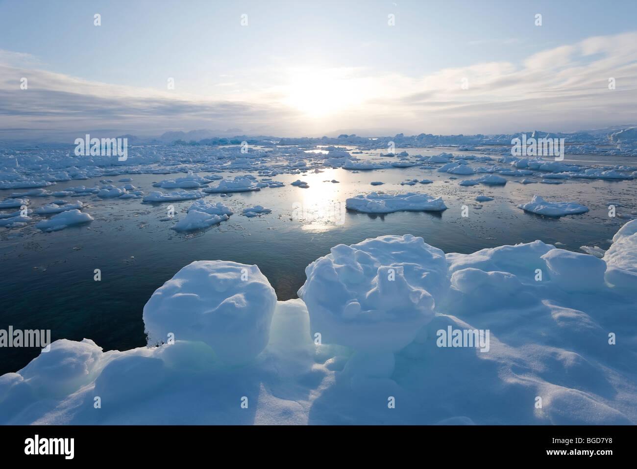Sea ice in fjord, Tiniteqilaq, Greenland - Stock Image