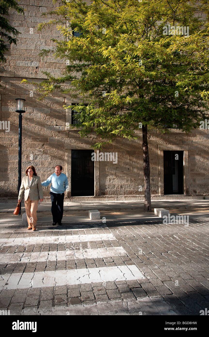 Locals of El Escorial in Madrid, Spain. UNESCO World Heritage Site. Stock Photo