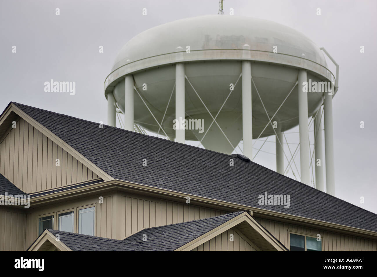 The Top Of A Residential House With A Large Water Tower Prominent