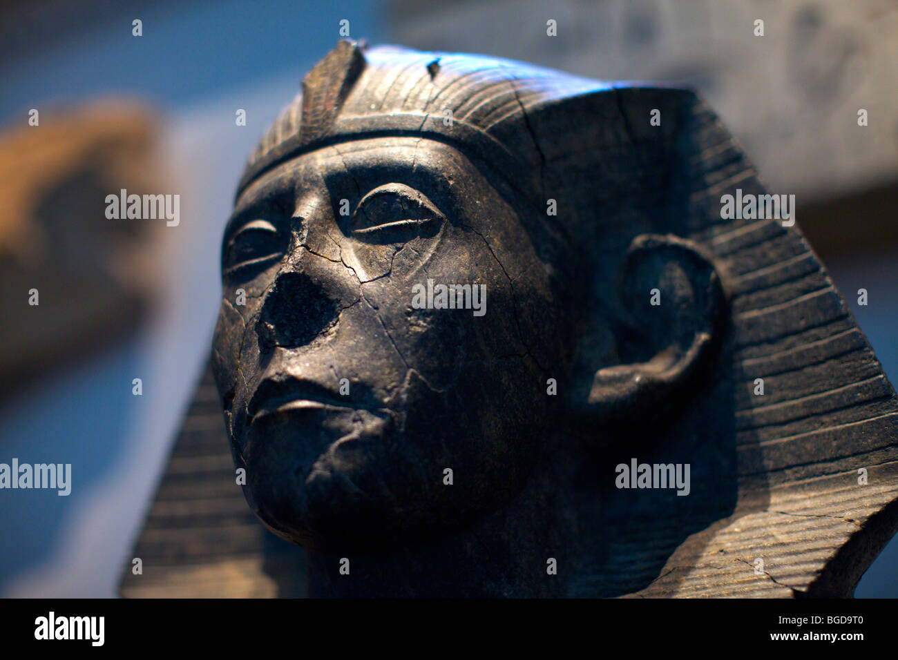Close up of a defaced black granite statue of egyptian King Sesostris III from 1850BC in the British Museum in London - Stock Image