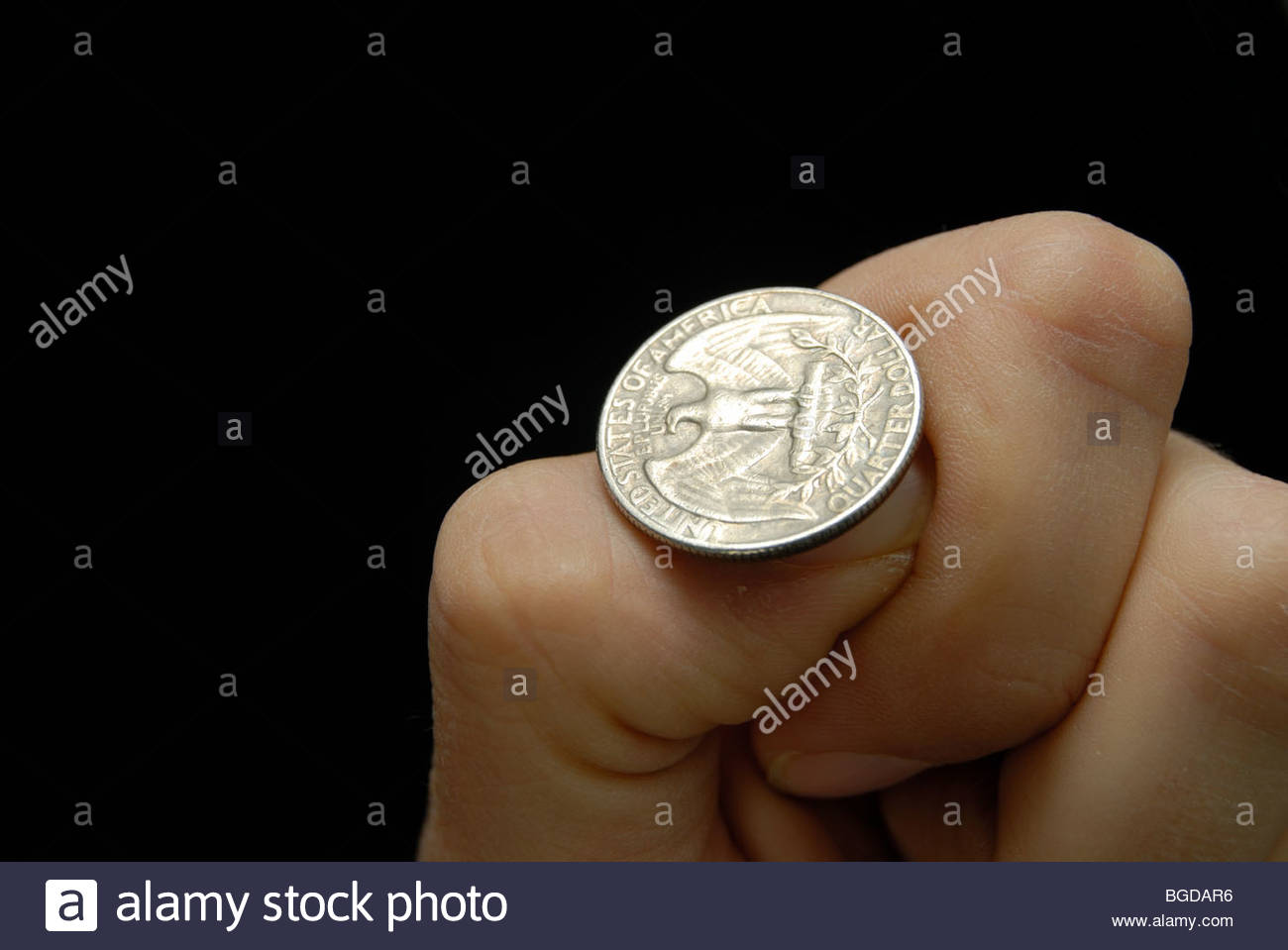 Flipping a US quarter (25c) coin. - Stock Image