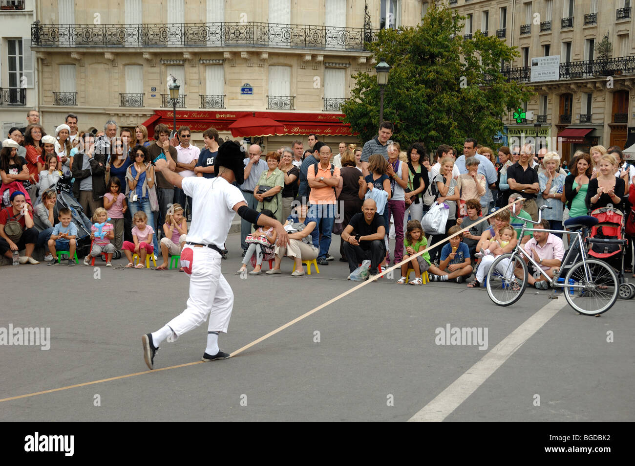 Street Theatre or Street Entertainer Balancing on Imaginary Tightrope, Pont Saint Louis, Île Saint Louis, Paris, - Stock Image