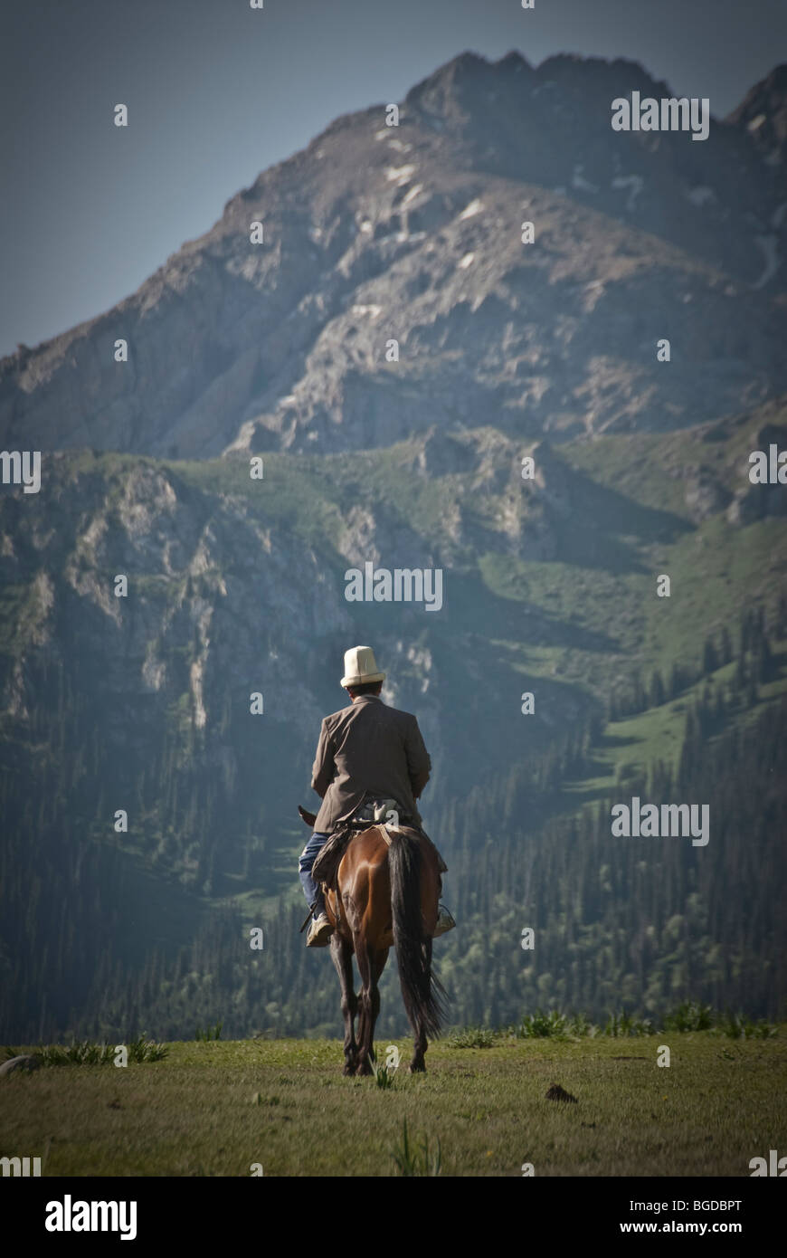 kyrgyz horseman in the mountains around karakol, Kyrgyzstan Stock Photo
