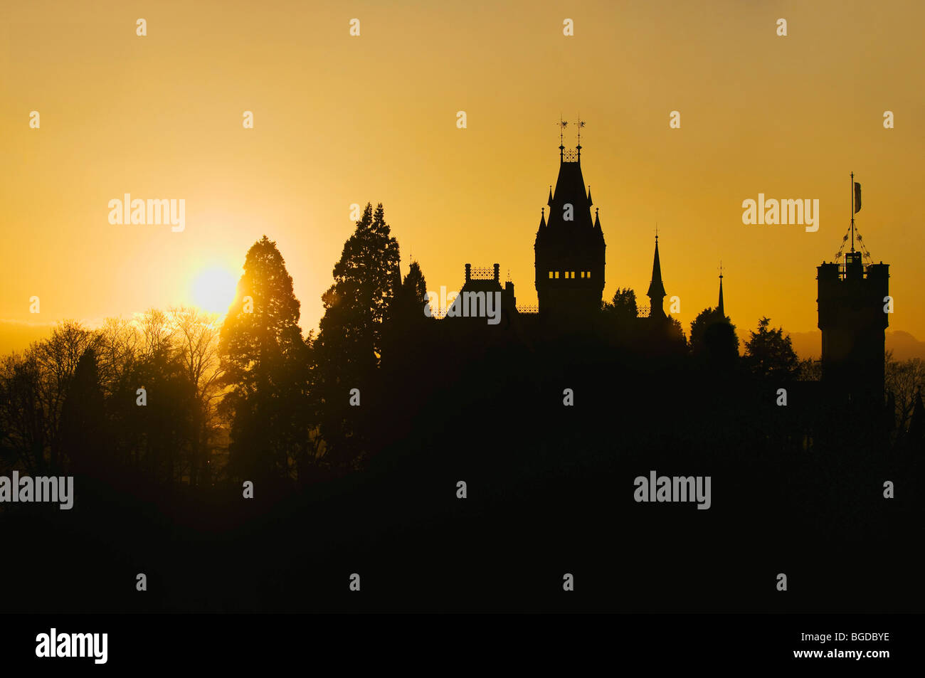 Schloss Drachenburg Castle with backlighting, silhouette, Koenigswinter, North Rhine-Westphalia, Germany, Europe - Stock Image