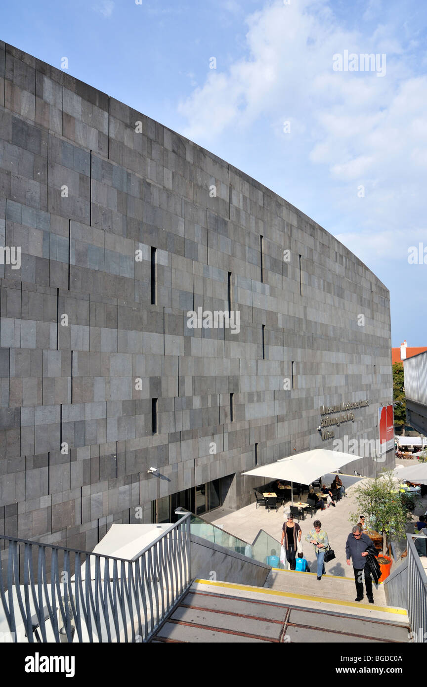 People on Stairs outside MUMOK (Museum Moderner Kunst or Museum of Modern Art) Building at MuseumsQuartier in Vienna, - Stock Image